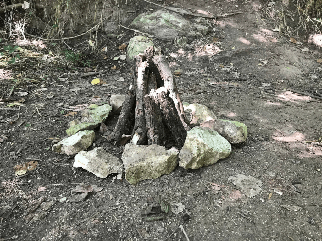 teepee fire structure on dirt
