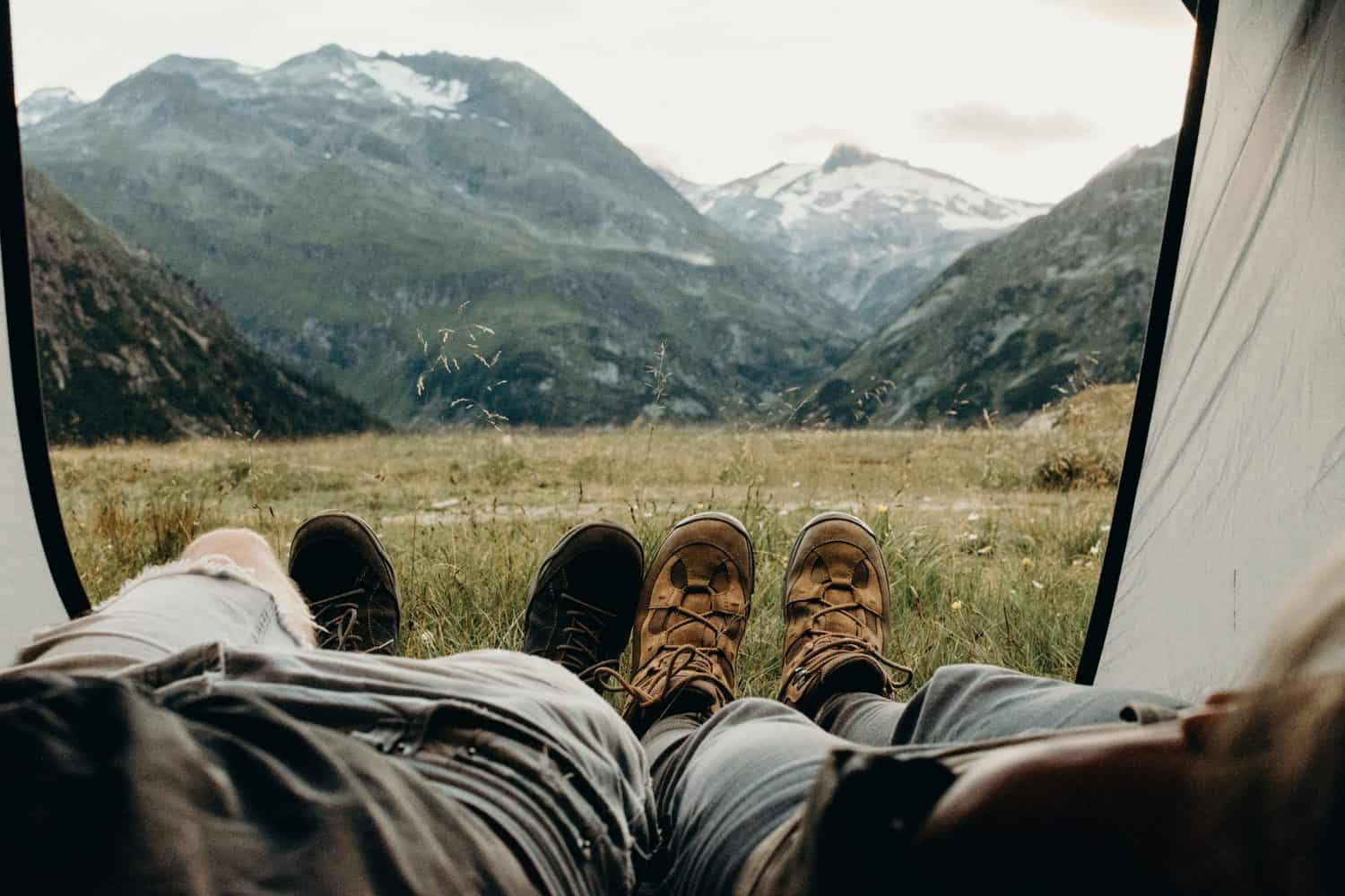 couples feet with mountain backdrop