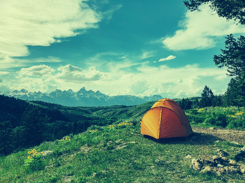 tent with mountain background