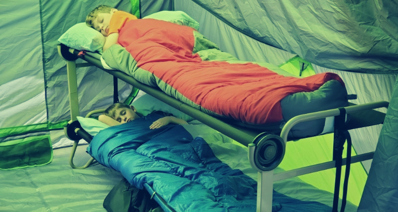 bunk cots with kids sleeping inside