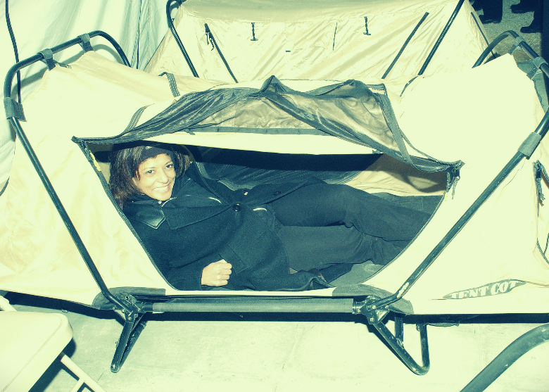 women inside tent cot