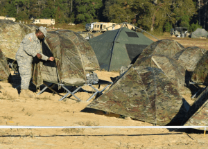 army man going inside tent cot