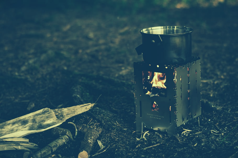 steel wood burning camp stove with pot