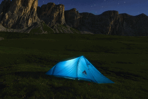 blue tent in outdoors at night