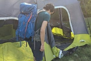 Man wearing budget backpack for camping