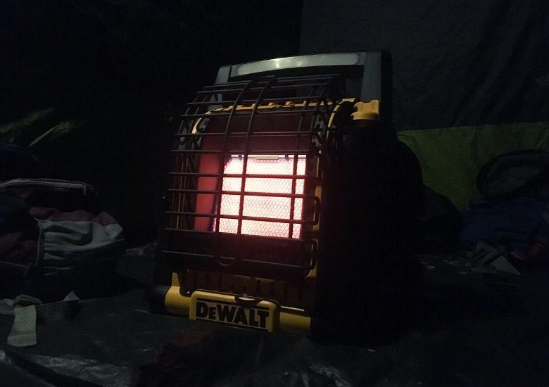gas heater running inside a tent