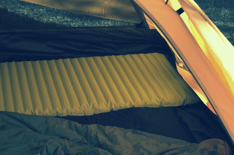yellow sleeping pad inside tent