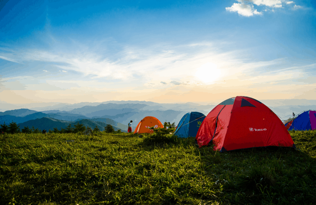 several tents on top of a mountain