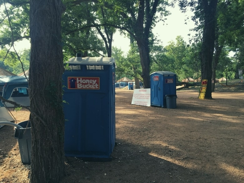 porta potties next to trees