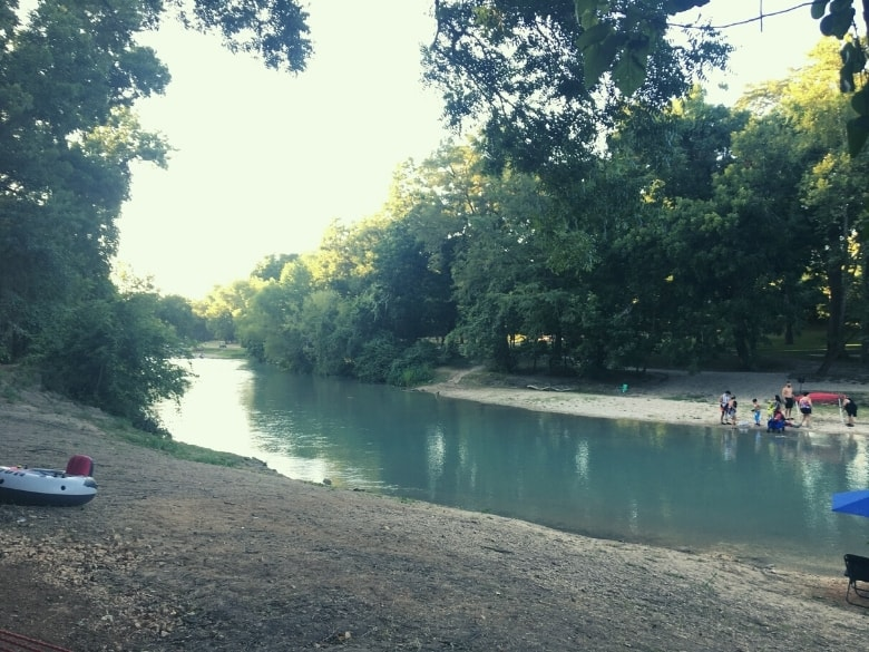 san marcos river with trees on either side