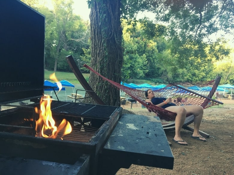 grill with fire and woman in hammock