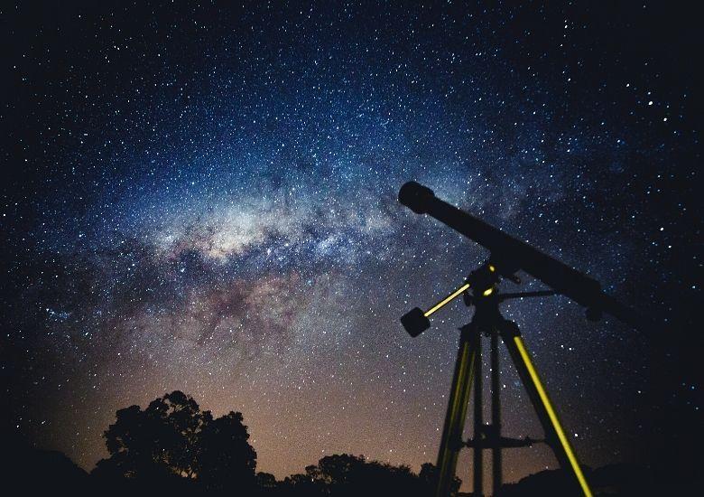 telescope in front of milky way